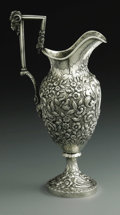 Silver Holloware, American:Ewers and Basins, An American Silver Ewer. The Kirk Corporation, Baltimore, MD,c.1830. The footed repousse ewer decorated with a heavy flor...