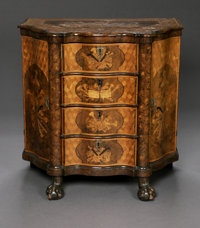 A Dutch Marquetry Commode eighteenth century  A small Dutch shaped four drawer commode with marquetry inlay panels of