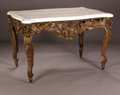 Furniture: French, A Nineteenth Century Italian Center Table. finely carved piercedbase in Rococo style with a broad apron revealing a pierc...