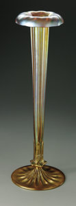 Art Glass:Tiffany , An American Glass Vase. Tiffany Studios, c. 1900.. Fluted trumpetform Favrille glass vase with gilt bronze petal snapped ba...