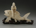 Miscellaneous: , A Japanese Ivory Fish. Maker unknown. Carved ivory catfish and man,on a wooden base formed like a leaf, unsigned. Ove...