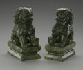 Decorative Arts, Continental:Other , A Pair of Carved Foo Lions. Chinese,Twentieth Century. A pair ofcarved hardstone foo lions with accoutrements, set on...