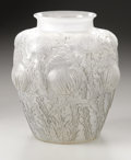 Art Glass:Lalique, A French Glass Vase. R. Lalique, 1926. In the 'Domremy' patterndepicting thistles with a dark grey patination, marked...