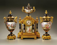 A Sevres-Style Porcelain And Gilt Bronze Clock Set Paris, France, late nineteenth/early twentieth centuryA three piece F...