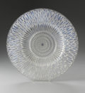 Art Glass:Lalique, A French Glass Bowl. R. Lalique, 1930. The clear and opalescentbowl in the 'Flora-Bella' pattern, marked to the side ...