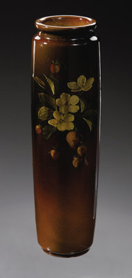 An American Pottery Vase Rookwood Pottery, 1891  The cylindrical vase in brown, decorated by William P. McDonald depi