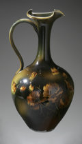 Ceramics & Porcelain, An American Ceramic Ewer. Rookwood Pottery, 1892. The green, brown and black glazed ewer with floral pattern to the si... (Total: 1 Item Item)
