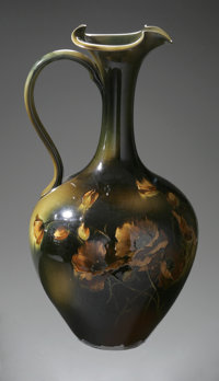 An American Ceramic Ewer Rookwood Pottery, 1892  The green, brown and black glazed ewer with floral pattern to the si