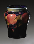 Ceramics & Porcelain, British:Modern  (1900 1949)  , An English Pottery Vase. W. Moorcroft, Mid-Twentieth Century. Thedeep blue ground vase decorated with fruit to the sh...