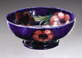 Ceramics & Porcelain, British:Modern  (1900 1949)  , An English Pottery Bowl. Moorcroft, Early Twentieth Century. Thedeep blue bowl decorated with stylized flowers, signa...