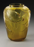 Art Glass:Other , A French Glass Vase. Sabino, Twentieth Century. The amber coloredvase with a raised cockatoo pattern to the surface, ...