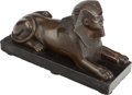 Bronze:European, AN EGYPTIAN REVIVAL BRONZE SPHINX PRESENTED ON ONYX BASE, 20th century. 6-1/4 x 10-1/2 x 3-3/4 inches (15.9 x 26.7 x 9.5 cm)...