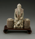 Paintings: , A Japanese Ivory Figure. Maker unknown. Carved ivory man with two baskets, intricately engraved and colored details to...