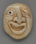 Miscellaneous: , A Ivory Mask Netsuke. Maker unknown. The carved ivory comical facewith a pierced ball attached to the reverse, unsign...