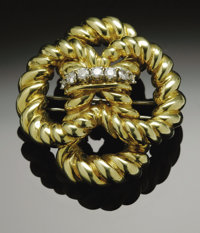 An 18K Gold Tiffany & Co. Brooch Accented With Diamonds  The Yellow gold brooch weighing 40.2 gms. Marked Tiffany &a...