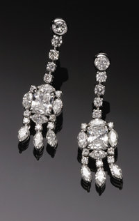 Platinum And Diamond Dangle Style Earrings  The platinum earrings weighing 8.6 grams with friction style posts and backs...
