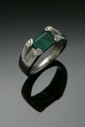 Estate Jewelry:Rings, A Gent's Platinum Fashion Ring Centered With An Emerald AndDiamonds. The band weighing 14.8 gms mounted with one emerald ...