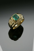 Estate Jewelry:Rings, A Gent's 18K Yellow Gold Fashion Ring Centered With An Emerald AndDiamonds. The band weighing 13.2 gms mounted with one e...