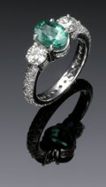 Estate Jewelry:Rings, A Ladies 18K White Gold Emerald And Diamond Ring. The 18K whitegold ring weighing 7 grams set with an oval faceted emeral...