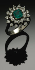 Estate Jewelry:Rings, A Ladies 18K White Gold Fashion RIng With Emerald And Diamonds. Thewhite gold band weighing 6.9 gms mounted with one squa...