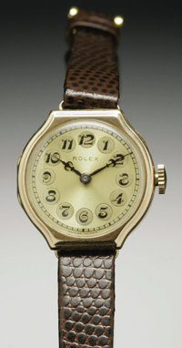 A Ladies Vintage 14K Gold Rolex Wrist Watch  The 15 jewel movement contained within the yellow gold case, face with Arab...