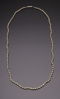 A Ladies Natural Pearl Strand with Diamond Clasp  The graduated single strand of 121 pearls weighing a total of 7.9 gram...