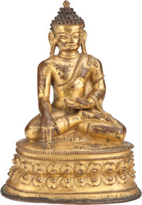 A CHINESE GILT BRONZE FIGURE OF BUDDHA 6-3/8 inches high (16.2 cm)