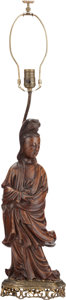 Asian:Chinese, A CHINESE CARVED WOOD GUANYIN MOUNTED AS A LAMP WITH BRASS BASE. 34inches high (86.4 cm). ...