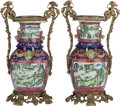 Asian:Chinese, A PAIR OF CHINESE ROSE CANTON PORCELAIN URNS WITH GILT BRONZEMOUNTS. 18-3/8 inches high (46.7 cm). ... (Total: 2 Items)