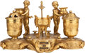 Decorative Arts, Continental:Other , A NAPOLEON III GILT BRONZE TWO-LIGHT FIGURAL CALENDAR ENCRIER, 19thcentury. 7 inches high x 13 inches inches diameter (17.8...