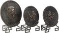Decorative Arts, American, THREE POMPEIAN-STYLE CAST METAL SHIELDS PRESENTED ON METAL STANDS, 20th century. 20 inches high (50.8 cm) (largest). ... (Total: 3 Items)