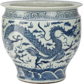 Asian:Chinese, A CHINESE BLUE AND WHITE PORCELAIN JARDINIÈRE. 19 inches high x 24inches diameter (48.3 x 61.0 cm). ...
