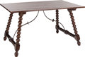 Furniture : Continental, A SPANISH WALNUT AND WROUGHT IRON TRESTLE TABLE, 20th century. 31 x55 x 34 inches (78.7 x 139.7 x 86.4 cm). ...