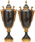 Paintings, A PAIR OF LOUIS XVI-STYLE FIGURAL GILT BRONZE MOUNTED MARBLE URNS, 20th century. 21-1/2 inches high (54.6 cm). ... (Total: 2 Items)
