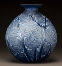 R. LALIQUE BLUE GLASS MILAN VASE WITH WHITE PATINA Circa 1929. Molded R. LALIQUE<