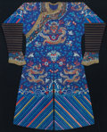 Asian:Chinese, A CHINESE FRAMED SILK ROBE, 20th century. 63-1/2 inches high x52-1/2 inches wide (161.3 x 133.4 cm). ...