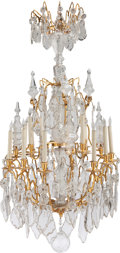 Lighting:Chandeliers, A LOUIS XV-STYLE GILT BRONZE SIXTEEN-LIGHT CHANDELIER, 20th century. 51 inches high x 29 inches diameter (129.5 x 73.7 cm). ...