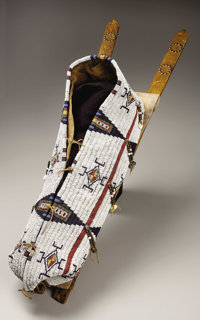 A NORTHERN CHEYENNE BEADED HIDE BABY CARRIER  c. 1880