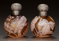 Art Glass:Other , A PAIR OF ENGLISH OVERLAY GLASS FLORAL PERFUME BOTTLES WITH SILVERMOUNTS. Circa 1887. Stamped to silver hallmarks for B... (Total: 2Items)