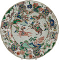 Asian:Chinese, A CHINESE FAMILLE VERTE PAINTED PORCELAIN CHARGER. Marks: (blueleaf underglaze within double rings). 14-3/4 inches diameter...