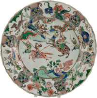 A CHINESE FAMILLE VERTE PAINTED PORCELAIN CHARGER Marks: (blue leaf underglaze within double rings) 14-3/4 inch