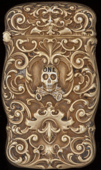 AN AMERICAN SILVER GILT AND ENAMEL SKULL & KEYS MATCH SAFE, circa 1900 Marks: STERLING 2-1/2 inches