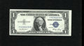 Error Notes:Miscellaneous Errors, Fr. 1614 $1 1935E Silver Certificate. About Uncirculated. The back shows a nice cutting error....