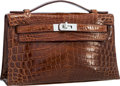 """Luxury Accessories:Bags, Hermes Shiny Miel Nilo Crocodile Kelly Pochette Bag with Palladium Hardware . Very Good to Excellent Condition . 8.5"""" ..."""