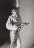 Photographs, LUCIEN CLERGUE (French, b. 1934). Violinist, Arles, 1954. Gelatin silver, printed 1983. 10-1/2 x 7-5/8 inches (26.7 x 19...