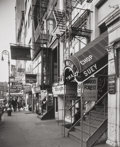 Photographs, BERENICE ABBOTT (American, 1898-1991). West 8th Street, circa 1947. Early gelatin silver. 8-3/4 x 7-1/8 inches (22.2 x 1...