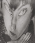 Photographs, BERENICE ABBOTT (American, 1898-1991). Self Portrait with Distortion, circa 1945. Ferrotyped early gelatin silver. 8-3/4...