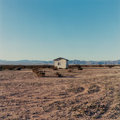 Photographs, John M. Divola (American, b. 1949). Isolated House, 1995. Dye coupler. 14 x 14 inches (35.6 x 35.6 cm). Signed and dated...