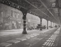 Photographs, TODD WEBB (American, 1905-2000). Under 3rd Avenue El, New York, 1946. Gelatin silver, printed 1976. 9-1/2 x 12-1/4 inche...