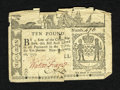 Colonial Notes:New York, New York February 16, 1771 £10 Fine. This bright note has beensplit in half and pinned together. Several edge tears are no...